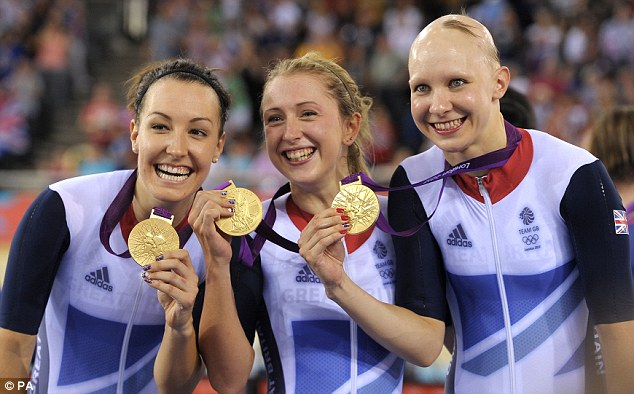 Great Britain's (left to right) Laura Trott and Dani King celebrate after winning the Women's Team Pursuit Final at the Velodrome in the Olympic Park