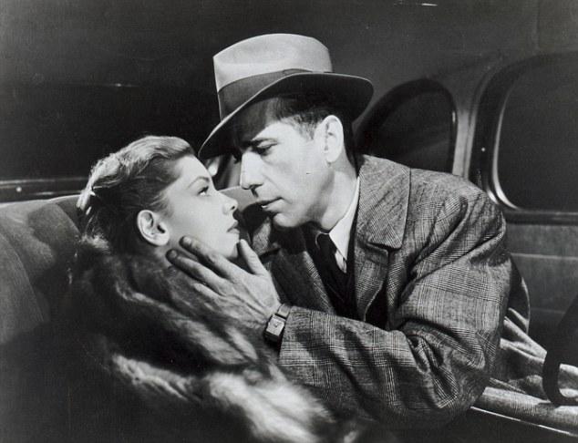 Worlds apart: Humphrey Bogart with Lauren Bacall, as Marlowe in the 1946 film The Big Sleep
