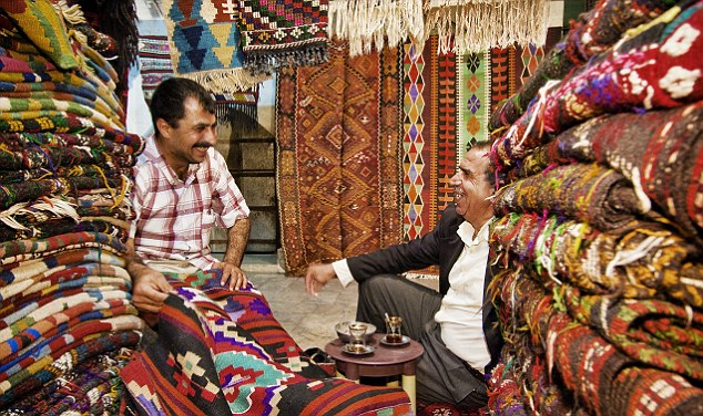 In Sanliurfa, Turkey, a carpet seller enjoys a drink. More than half of the country's population is classed as 'inactive'