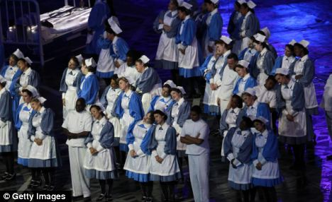 Donation: Performers from Great Ormond Street Hospital - which is to receive £12,000 so far - during the Opening Ceremony of the Games