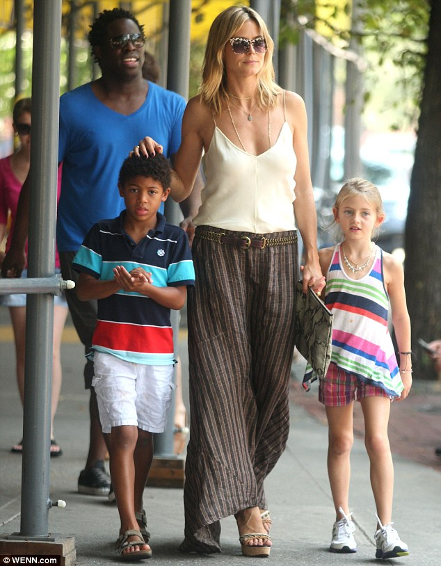 Project runaway: Heidi Klum was way out front with her ambrosial children Leni and Henry while Seal's brother marched behind in New York today