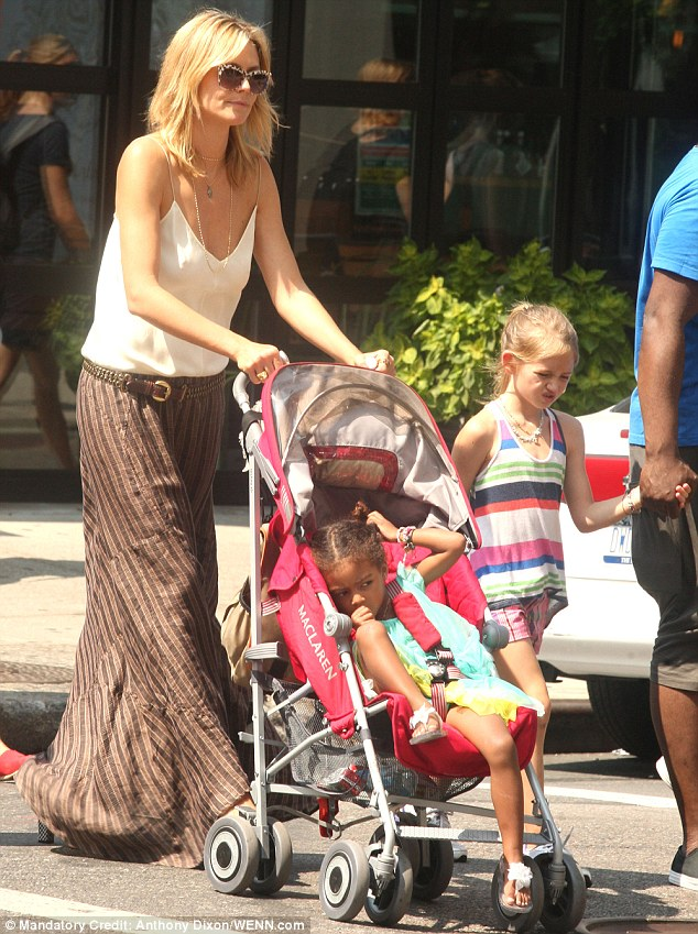 Pushy parent: Heidi did not mind taking pram pushing duties while her brother-in-law held hands with the others