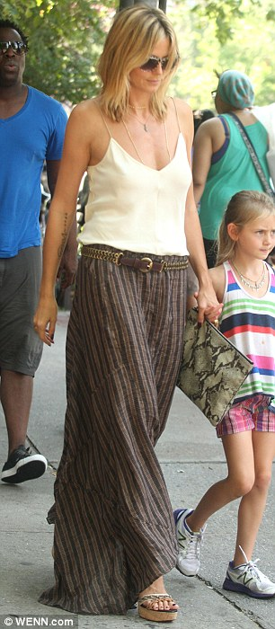 Bad news: Heidi's phone call did little to cheer her mood as she went for a fun family stroll in the Big Apple