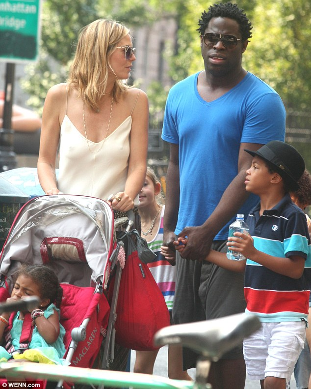 He doesn't know to look: Jeymes wisely tried to avert his eyes after Heidi gave passersby a thrill by going bra-less