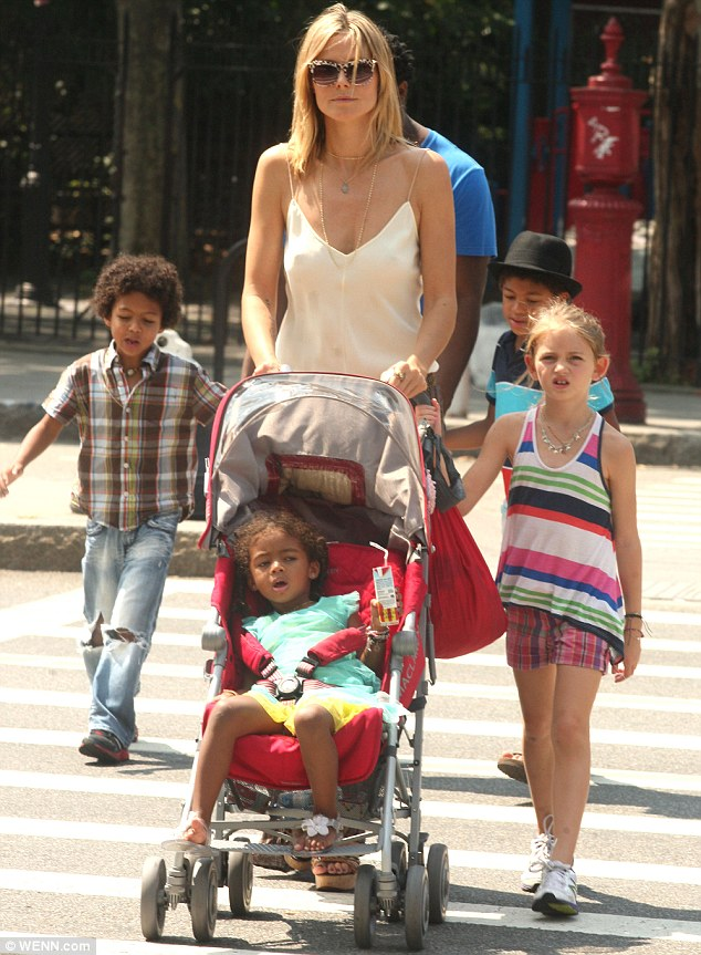 Talk about a handful: Jeymes wisely was a useful pair of hands as she walked with her bountiful brood
