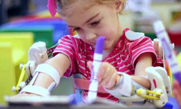 Gaining strength: Emma can now draw and lift things up, without the help from her mother