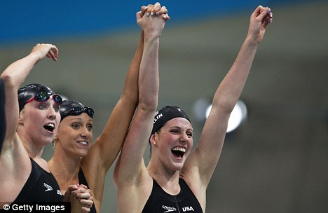 All smiles: Franklin and her team-mates celebrate winning the 4x200m freestyle relay