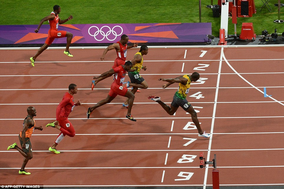 Outright winner: Usain Bolt streaks clear of the field to claim gold from lane seven in one of the most eagerly awaited Olympic events ever