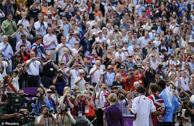 Magic Murray: The Wimbledon crowd rise to acclaim the Brit after he won gold in the single's final