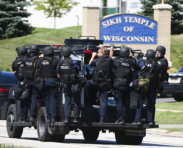 Nightmare: Armed police outside the Sikh Temple of Wisconsin in response to a massacre which left six worshippers dead on Sunday morning
