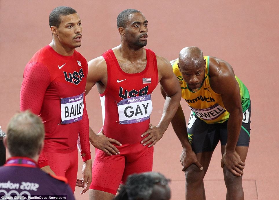 Left behind: Gay (center) had surgery on his hip last summer and was running on grass up until 4 1/2 months ago, because his hip was still too sore to take the pounding of track workouts