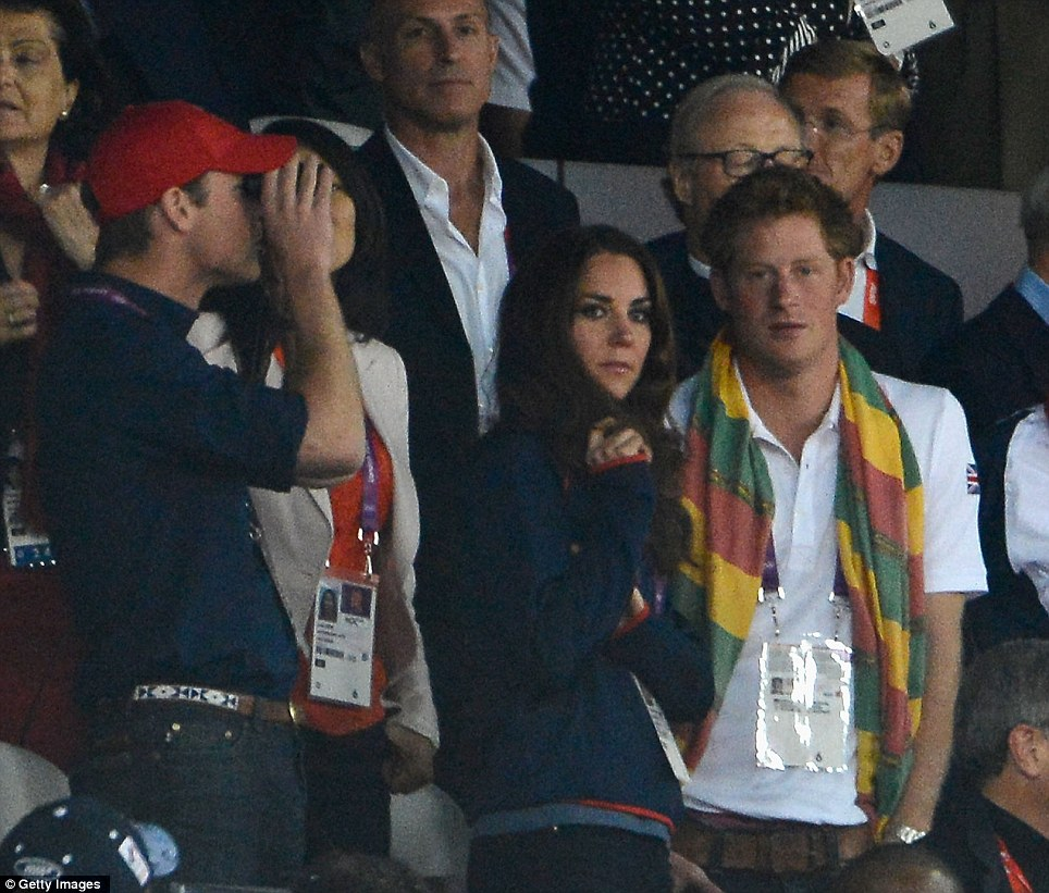 Behind Bolt: Prince Harry wore Jamaican colours as he accompanied his brother and sister-in-law at the athletics