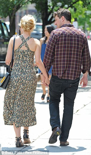 Summer stroll: The couple are famously private and rarely photographed in public together