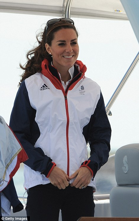 Kate wore her favourite Team GB supporters kit which kept her warm whilst she was out on the water, she tied back her usually lose curly locks