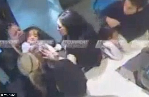 Scary: Nevaeh is picked up by her distraught parents at one point. She began to turn blue while staff battled to save her