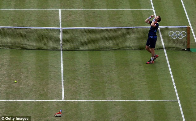 Signature: Murray did his trademark salute to the skies after his win