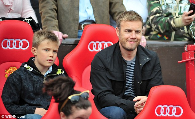 Loving them with all their hearts: Gary, pictured here with his son Daniel last year, is spending time with his eldest and his two daughters Emily and Daisy