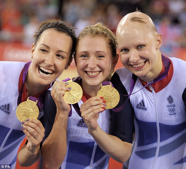 Trott, centre, celebrates her team sprint gold medal with teammates Dani King, left, and Joanna Rowsell, right