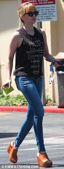'Sinful' star: The 21-year-old niece of Julia Roberts was seen wearing Truly Madly Deeply's $29 French cross text muscle tank top, which is written in French