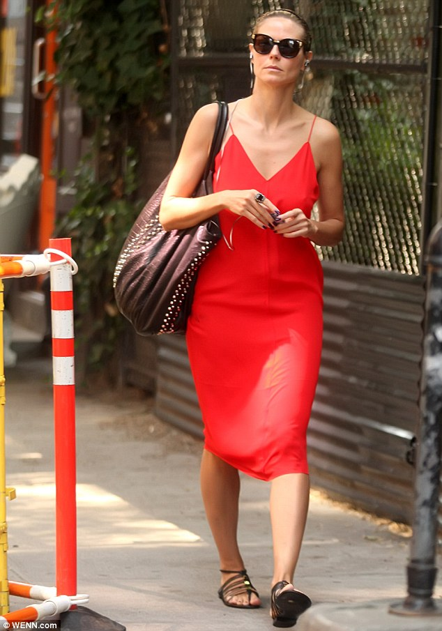 Lady in red: Earlier in the day, Heidi turned heads in a glamorous red dress as she shopped in Manhattan