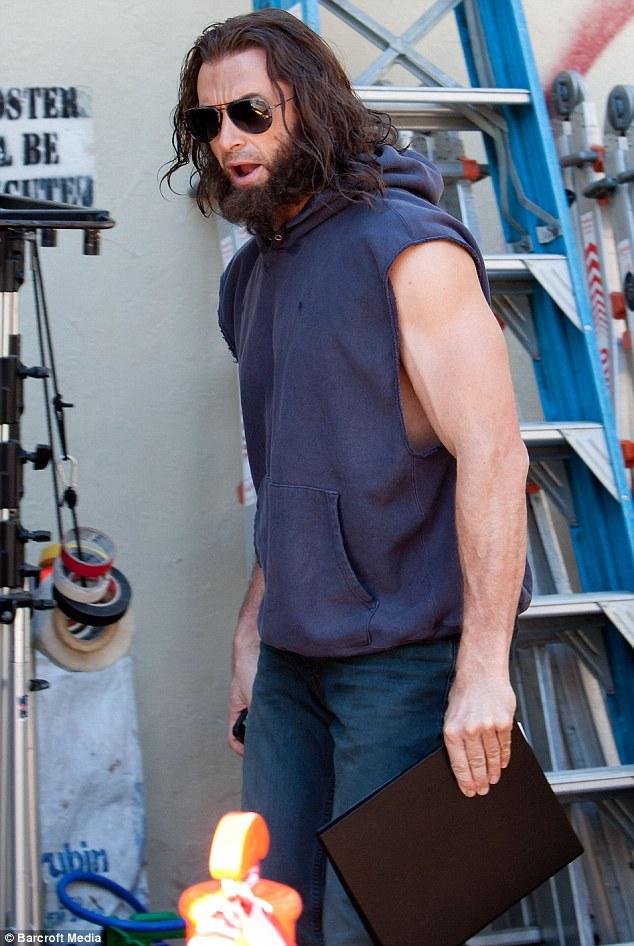 Bulging: Hugh Jackman showed off his bulging biceps on the set of his new movie X-Men Origins: Wolverine in Sydney, Australia today