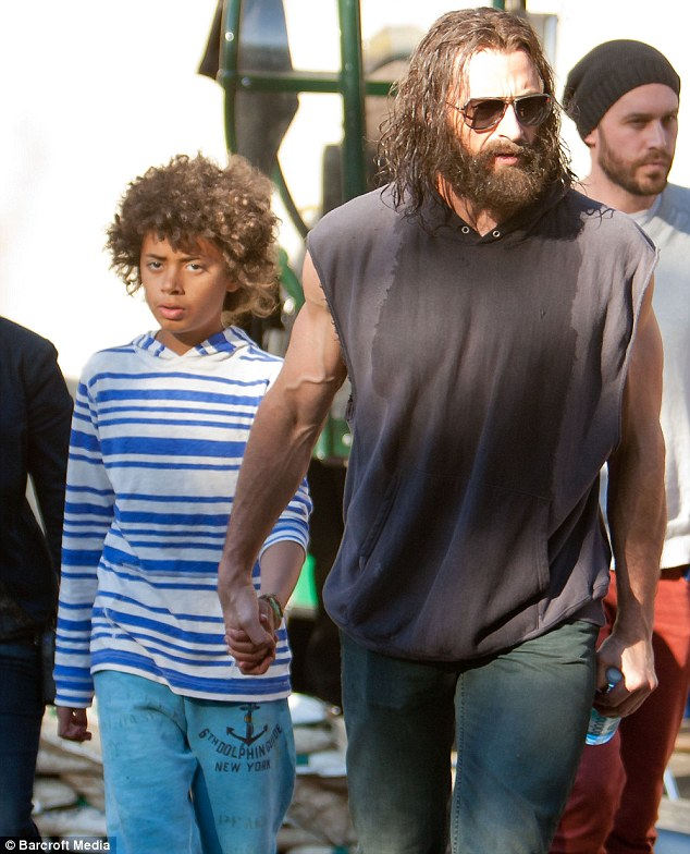 Joining in the fun: Hugh's son Oscar was also spotted with him on set