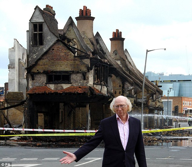Devastating: Trevor Reeves' father, Maurice, outside the gutted showroom after a third night of violence in London in August last year