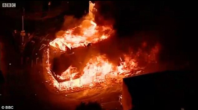 Inferno: The sight of House of Reeves burning to the ground was one of the most evocative images of the London riots