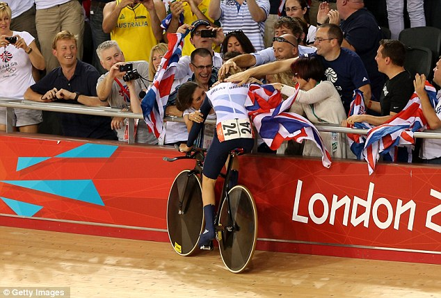 After winning gold, Laura Trott pedalled straight to where her friends and family were seated and threw herself into the crowd for a warm embrace