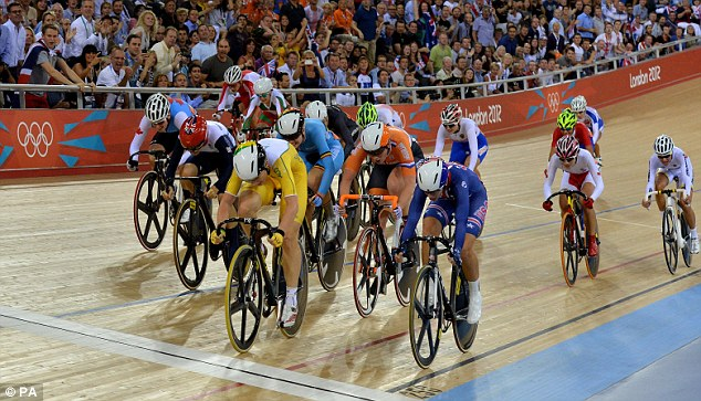 Close call: Trott (second left) scrapped into third in a tight scratch race in the Velodrome