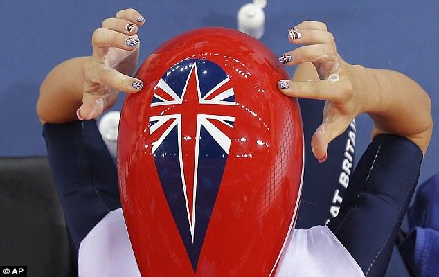 Nailing it: Trott adjusts her helmet ahead of her showdown with Sarah Hammer