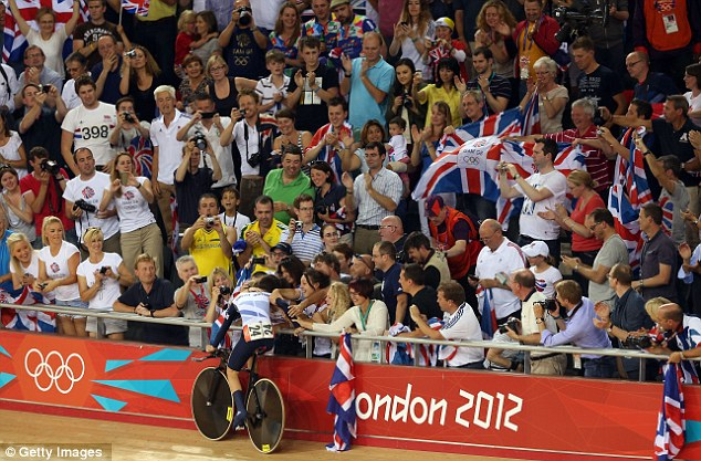 Group hug: Trott celebrates with her family in the crowd after sealing her incredible triumph