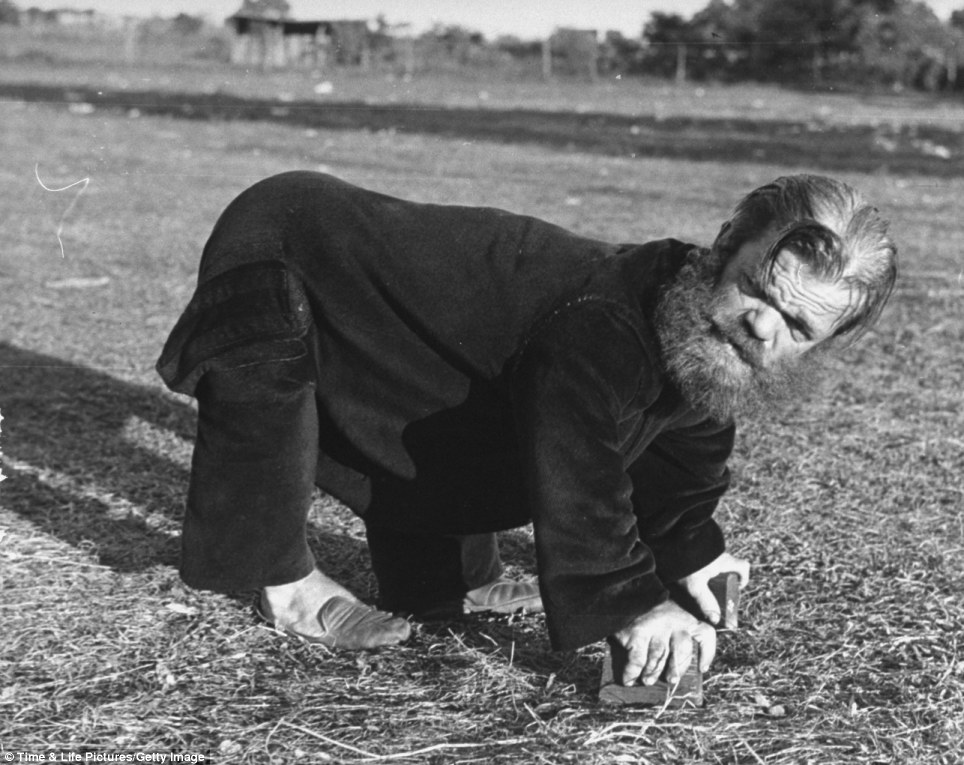 Not-so fairground: A dwarf, named Bear Man, is pictured on all fours in the style that makes him a sideshow attraction in carnival at the Greenbrier Valley Fair, West Virginia in 1938