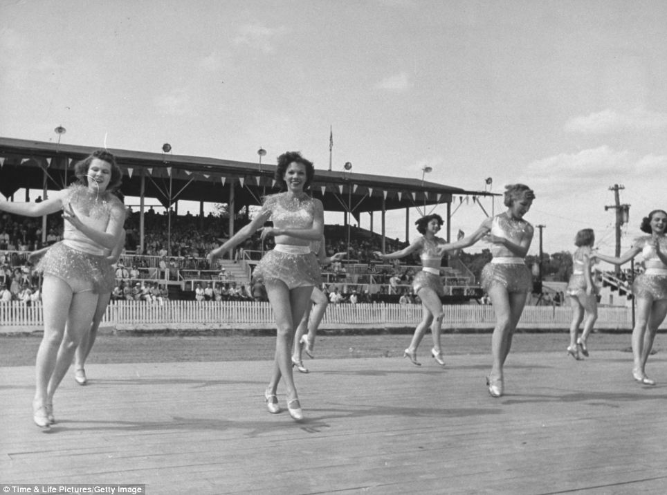 Stars: Eight Polly Ann dancers, who were the students of a Pennsylvania teacher, perform for the crowds. After the show, they were chaperoned away for their protection