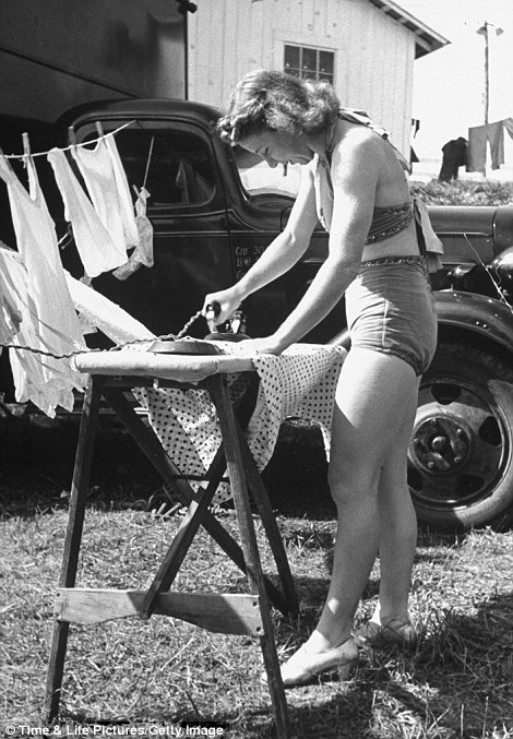 One of the eight Polly Ann dancers doing her ironing between performances at the Greenbrier Valley Fair
