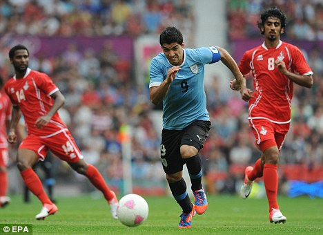 On the ball: Suarez in action against UAE at the Olympic Games