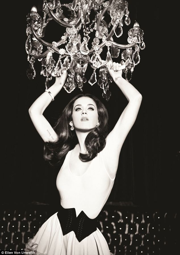 Adventurous: Katy Perry swings from the chandelier in the first set of campaign shots from ghd, released earlier this summer