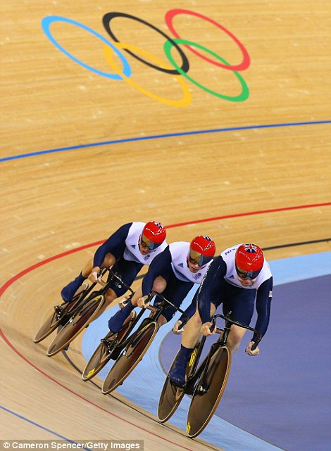 Thrill of the chase: Great Britain's men's team sprint riders Sir Chris Hoy, Kenny Jason and Philip Hindes take on the steep curves of the velodrome, while the starter's pistol sets off another race, right