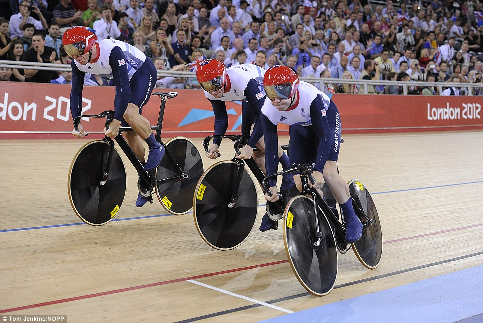 Team effort: Great Britain's men's team sprint riders Philip Hindes (right) Jason Kenyy (centre) and Sir Chris Hoy power away inside the velodrome