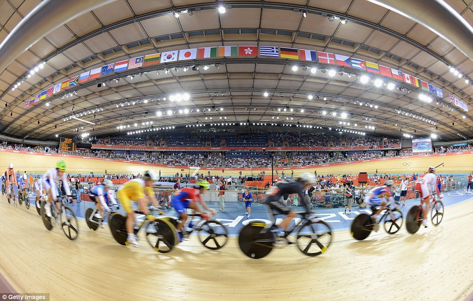 Ride of their lives: Female riders take to the Velodrome track for the women's omnium yesterday, in a venue which has become a Team GB fortress in the past six days