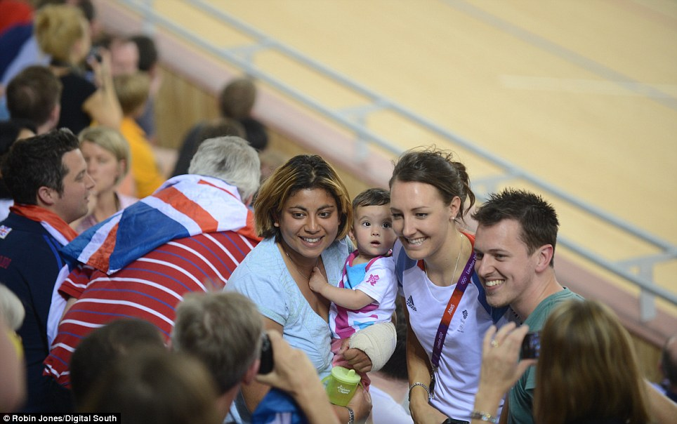 Picture perfect: Team GB's Dani King, from the women's team pursuit team, poses with fans before the sprint final yesterday