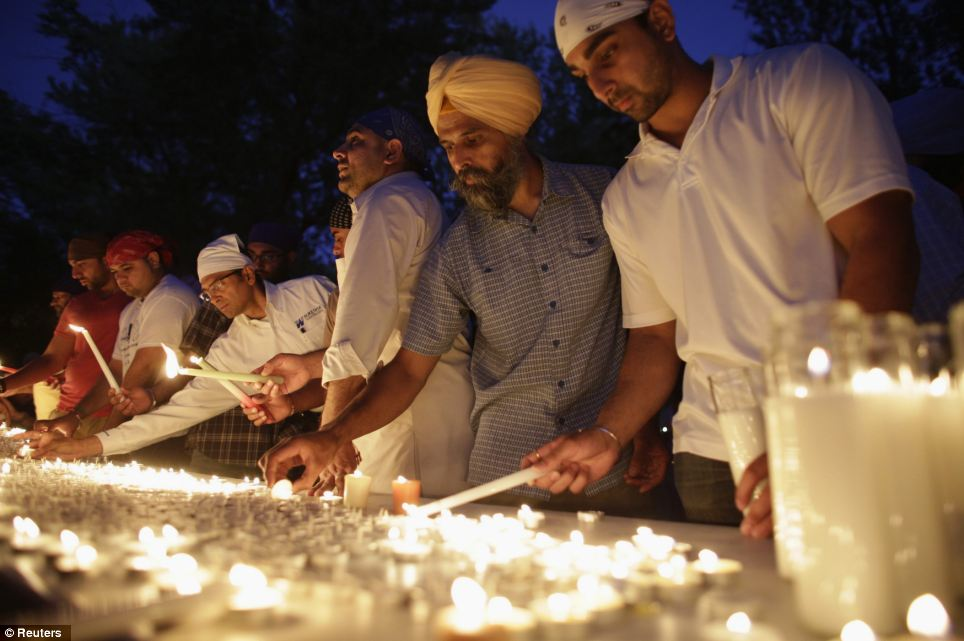 The gunman who killed six worshipers at a Sikh temple in Wisconsin was identified as a 40-year-old U.S. Army veteran Wade Michael Page