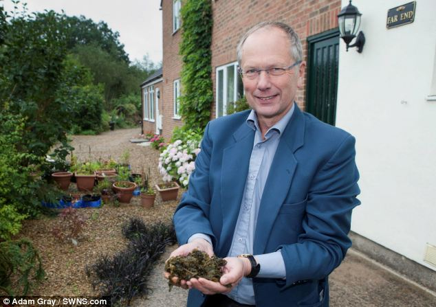 Front garden full: Dr Richard Overton was surprised to find his garden filled with seaweed and has struggled to clear it all up
