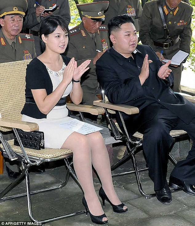 Luxury: Ri Sol-Ju, wife of North Korea's Supreme Leader Kim Jong-Un, has been pictured sporting what appears to be a Christian Dior handbag