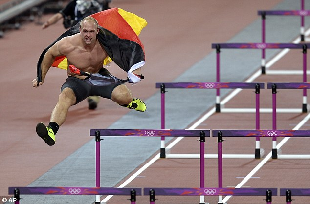 Don't stop me now: Harting, 27, showed impressive hurdling ability despite weighing in at 20-stone