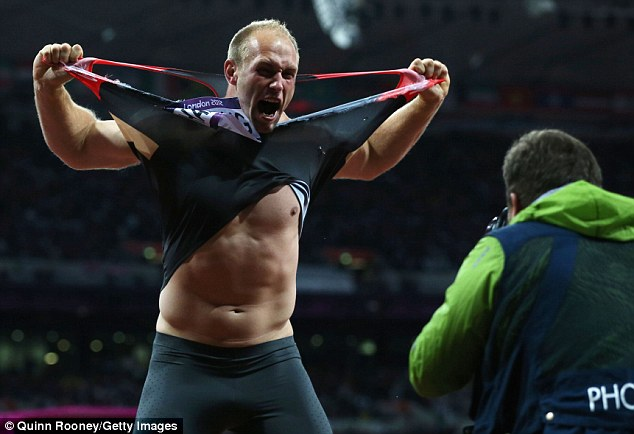 Celebration time: Harting was not shy in displaying his happiness at being crowned Olympic discus champion
