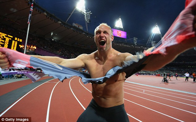 You wouldn't like him when he's angry: Robert Harting joyfully rips his shirt off Incredible Hulk-style after claiming gold last night in the discus