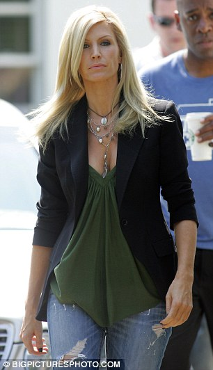 On top: Yvonne Keating chose a tailored and serious look to publicly announce she would stay by her cheating Boyzone husband, Ronan