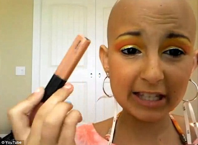 Finishing touches: Talia tells her fans that 'it's just for fun', explaining she did this make-up tutorial while her parents were in the pool and she ' was really bored'
