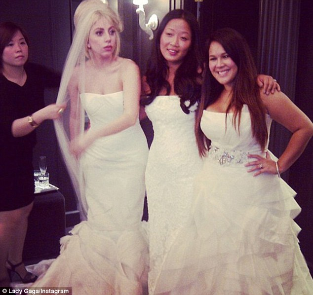 All dressed up: Lady Gaga poses with two ladies at the Vera Wang bridal boutique in New York - a photo that sparked rumours the singer was planning to walk down the aisle